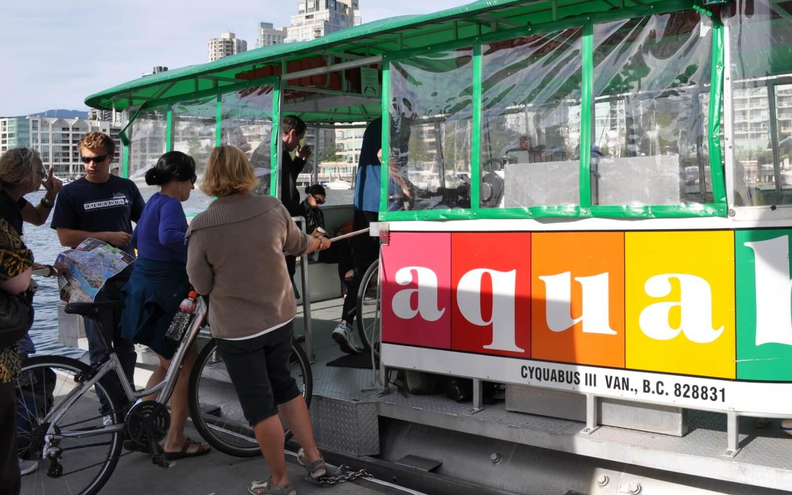 tourist boarding the aquabus at granville island in vancouver canada