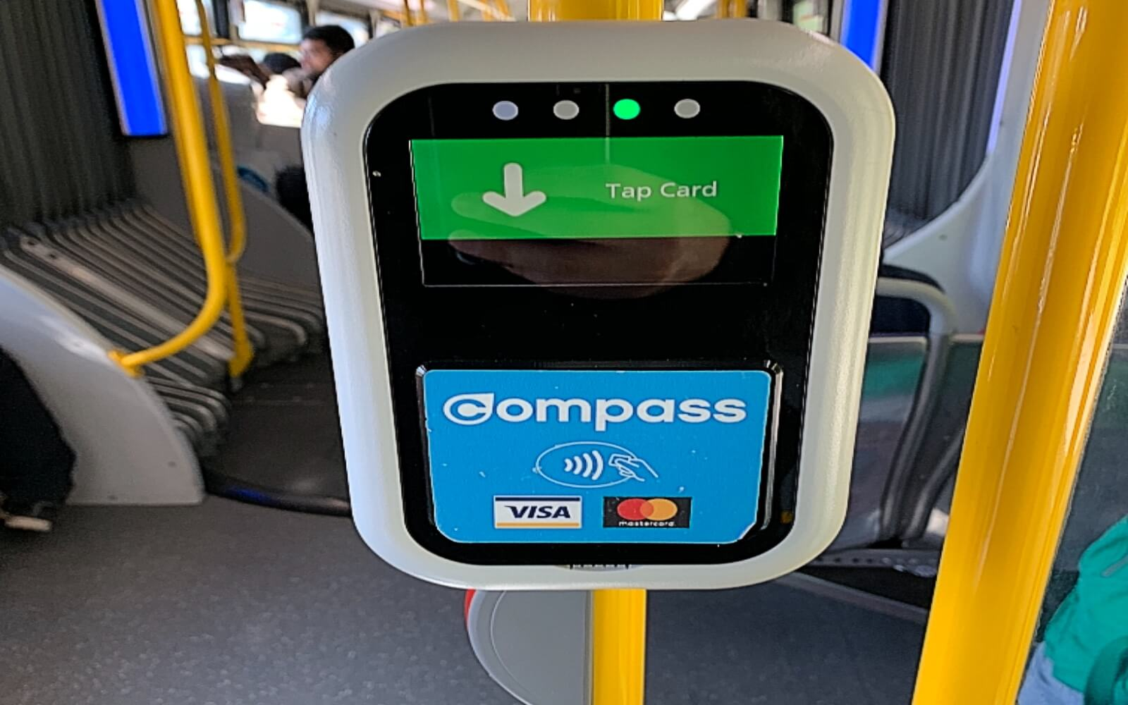 The Compass tap on a bus