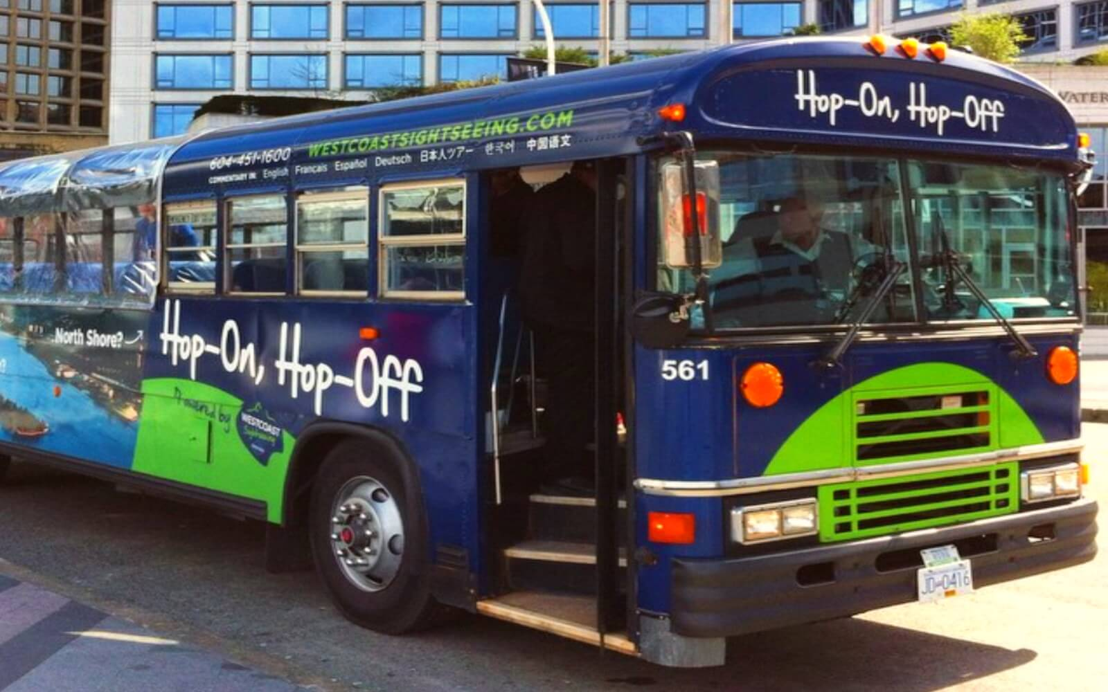 A Westcoast Sightseeing bus awaits boarding