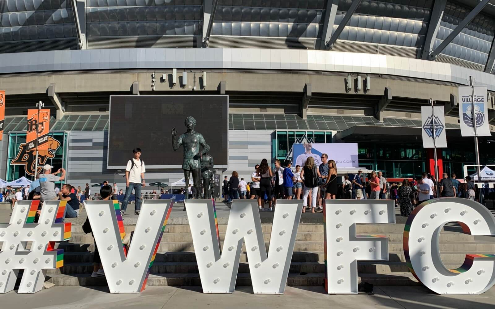fans gathering outside bc place for a whitecaps game hastag vwfc