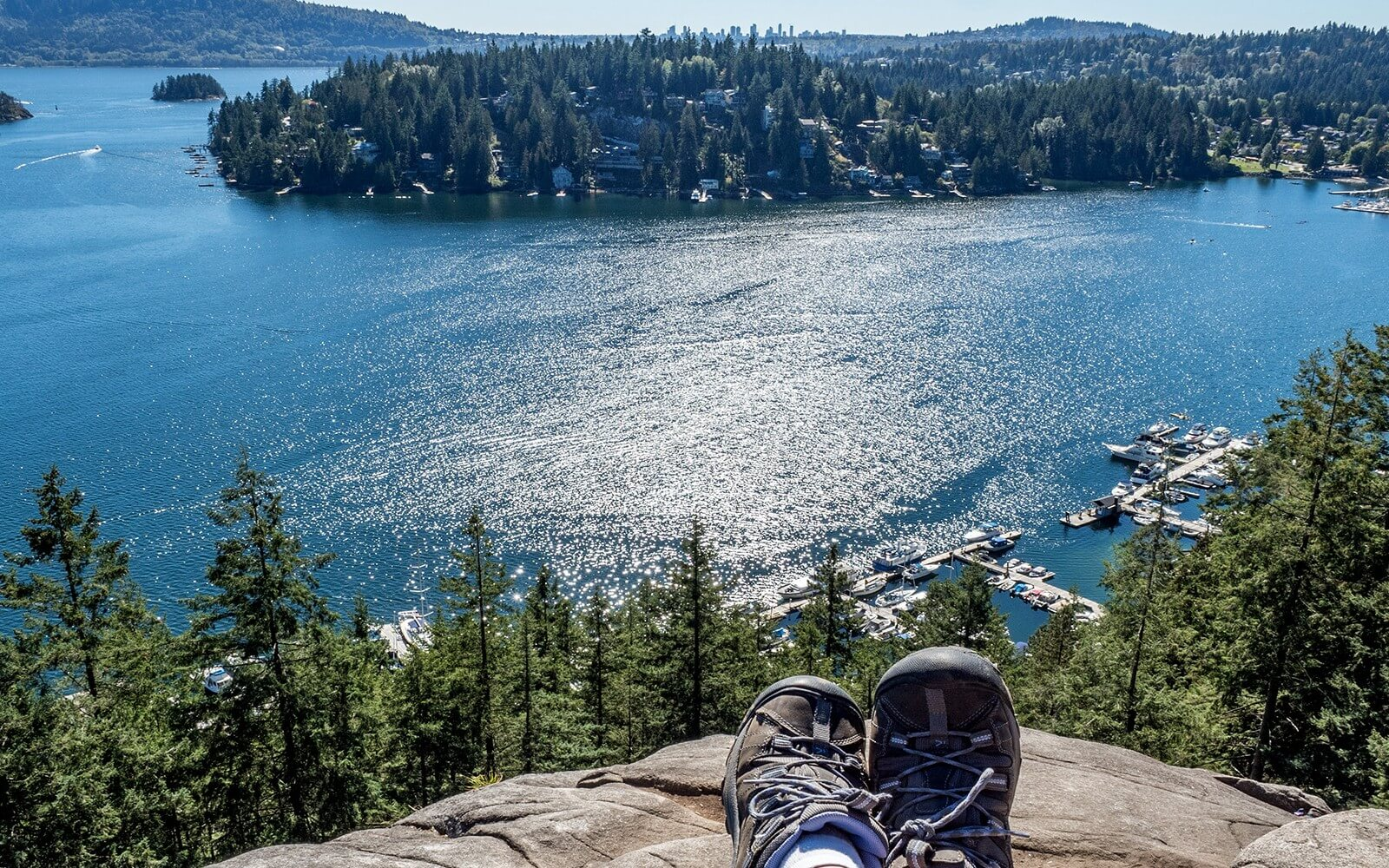 a hiker relaxes on quarry rock in north vancouver bc canada